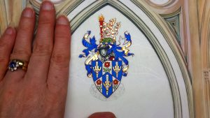 Heraldry Wells Cathedral with hand for scale